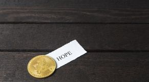 Bitcoin and written the word: Hope on paper. Stock Photography
