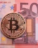 Bitcoin y euro Foto de archivo libre de regalías