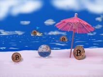 Bitcoins家庭在度假 免版税图库摄影