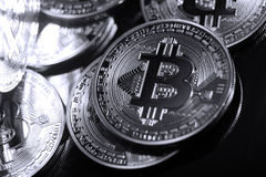 Bitcoins against a black background Royalty Free Stock Photos
