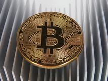 Bitcoins on aluminium profile Royalty Free Stock Photos