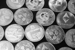 Free Bitcoins And Altcoins In Grayscale Stock Photo - 220189800