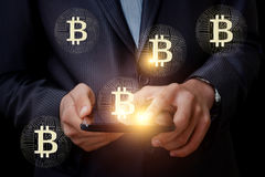 Bitcoins appear out of the tablet. Bitcoins appear out of the tablet concept design Royalty Free Stock Images