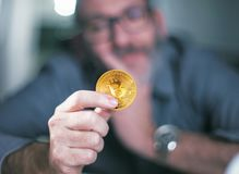 Bitcoin in hand of a businessman Royalty Free Stock Photos