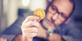 Bitcoin in hand of a businessman Royalty Free Stock Photo