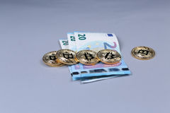 Bitcoins and British Pounds banknotes Stock Images