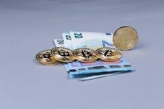 Bitcoins and British Pounds banknotes Stock Photos