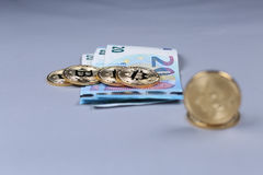 Bitcoins and British Pounds banknotes Stock Photography