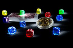 Bitcoins, cards, dices on black background. Cryptocurrencie gambling concept. Online, rich virtual stock photos