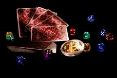 Bitcoins, cards, dices on black background. Cryptocurrencie gambling concept. Online, rich virtual royalty free stock images