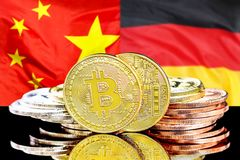 Bitcoins on China and Germany flag background. Bitcoins on the background of the flag China and Germany. Concept for investors in cryptocurrency and Blockchain royalty free stock photography