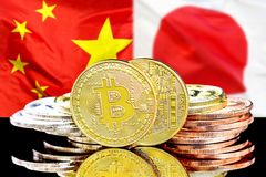 Bitcoins on China and Japan flag background. Bitcoins on the background of the flag China and Japan. Concept for investors in cryptocurrency and Blockchain stock photo