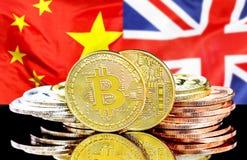 Bitcoins on China and United Kingdom flag background. Bitcoins on the background of the flag China and United Kingdom. Concept for investors in cryptocurrency royalty free stock photo