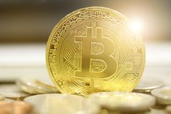 Bitcoins on coins baclground Stock Image