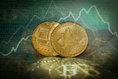 Bitcoins conceptual image with binary code background. Bitcoins conceptual image with golden coins and binary code background and diagram chart stock photography