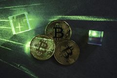 Bitcoins on concrete table with green laserbeam. Cryptovaluta concept. Hexagons and prisms. Futuristic stock images