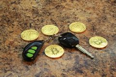 Bitcoins cryptocurency with car key Stock Image