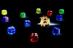 Bitcoins, dices on black background. Cryptocurrencie gambling concept,. Online, rich virtual stock image