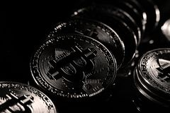 Bitcoins, black background. Bitcoins digital currency, financial industry, Black background stock photo