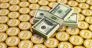 Bitcoins and Dollar bills Stock Image