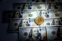 Bitcoins and dollars as an abstract symbol of crime that can hid. E cryptography stock photography