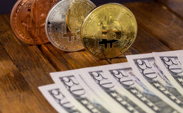 Bitcoins with dollars Royalty Free Stock Photo