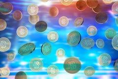 Bitcoins en baisse, fond brouillé Photographie stock libre de droits