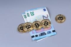 Bitcoins and Euro banknotes Stock Photography