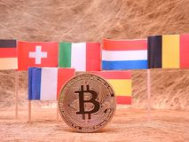 Bitcoins and a few European flags Stock Photography