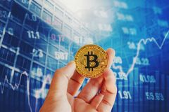 Bitcoins for finance and banking on digital stock market financial exchange and Trading graph Double exposure city on. The background stock image