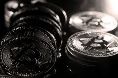 Bitcoins. Golden Bitcoins digital currency, financial industry, Black background stock photos