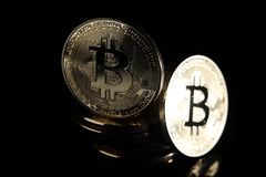 Bitcoins. Golden Bitcoins digital currency, financial industry, Black background stock images