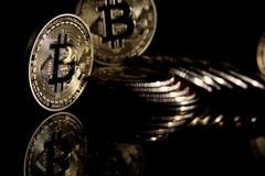 Bitcoins. Golden Bitcoins digital currency, financial industry, Black background royalty free stock images