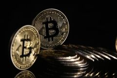 Bitcoins. Golden Bitcoins digital currency, financial industry, Black background royalty free stock image