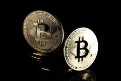 Bitcoins. Golden Bitcoins digital currency, financial industry, Black background royalty free stock photos