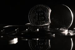 Bitcoins. Golden Bitcoins digital currency, financial industry, Black background stock photo