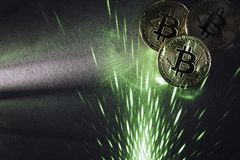 Bitcoins and green laser royalty free stock photo