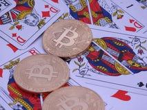 Bitcoins i otwarty pokład karty Fotografia Royalty Free