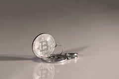 Bitcoins i pierścionki Obrazy Royalty Free