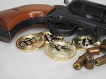 Bitcoins i pistolet obrazy royalty free