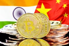 Bitcoins on India and China flag background. Concept for investors in cryptocurrency and Blockchain technology in the India and China. Bitcoins on the background stock photography
