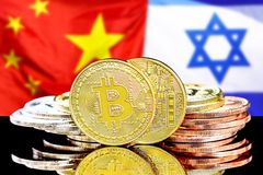 Bitcoins on Israel and China flag background. Bitcoins on the background of the flag Israel and China. Concept for investors in cryptocurrency and Blockchain royalty free stock photos