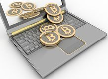 Bitcoins on laptop Royalty Free Stock Photo