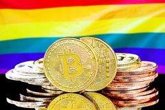 Bitcoins on LGBT gay flag background stock photography