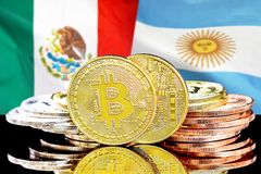 Bitcoins on Mexico and Argentina flag background. Concept for investors in cryptocurrency and Blockchain technology in the Mexico and Argentina. Bitcoins on the stock image