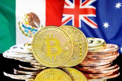 Bitcoins on Mexico and Australia flag background. Concept for investors in cryptocurrency and Blockchain technology in the Mexico and Australia. Bitcoins on the royalty free stock photography