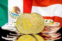 Bitcoins on Mexico and Austria flag background. Concept for investors in cryptocurrency and Blockchain technology in the Mexico and Austria. Bitcoins on the stock images
