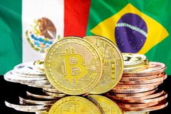 Bitcoins on Mexico and Brazil flag background. Concept for investors in cryptocurrency and Blockchain technology in the Mexico and Brazil. Bitcoins on the royalty free stock photography