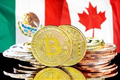 Bitcoins on Mexico and Canada flag background. Concept for investors in cryptocurrency and Blockchain technology in the Mexico and Canada. Bitcoins on the stock photo