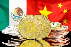 Bitcoins on Mexico and China flag background. Concept for investors in cryptocurrency and Blockchain technology in the Mexico and China. Bitcoins on the stock photos